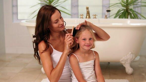 Thumbnail for Mother Brushing Her Little Girls Hair