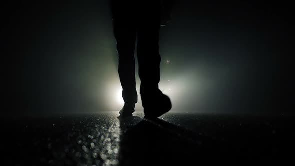 Cover Image for Spooky Night Scene of Male Feet Walking in Darkness