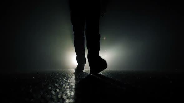 Thumbnail for Spooky Night Scene of Male Feet Walking in Darkness