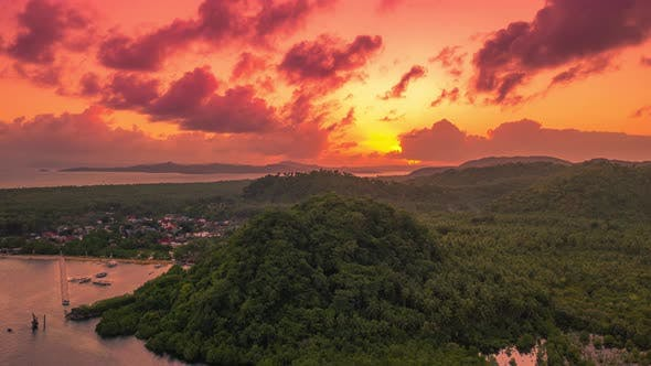 Cover Image for Sunset Overlooking the Mountain and Mangrove Jungle on the Siargao Island, Philippines. Aerial Drone