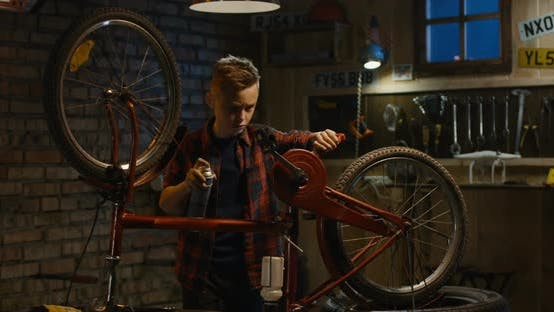 Thumbnail for Boy Repairing a Bicycle in a Garage