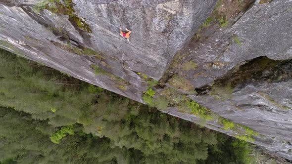 Thumbnail for Drone Looking Down On Extreme Sports Athlete Climbing Massive Rock Mountain