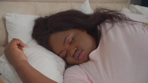 Overweight Woman Asleep in Bed Snoring at Night