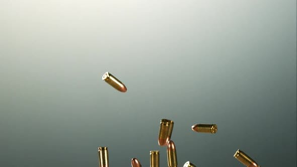 Bullets falling bouncing in ultra slow motion 1500fps on a reflective surface - BULLETS PHANTOM