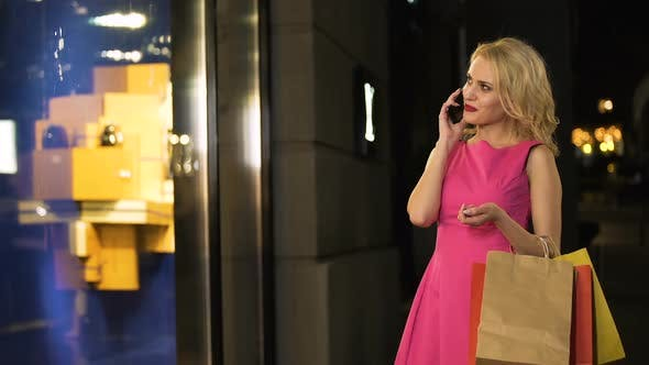 Cover Image for Flirty Blonde Having Phone Conversation Luxury Shopping at Fashion Boutique
