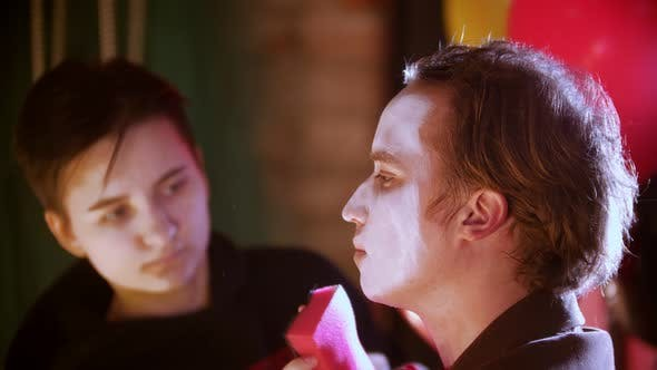 Thumbnail for Make-up Artist Applying Paint on the Man Clown in the Dressing Room