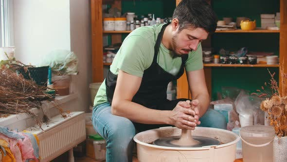 Cover Image for Pottery - the Master Is Wetting the Clay for Better Glide