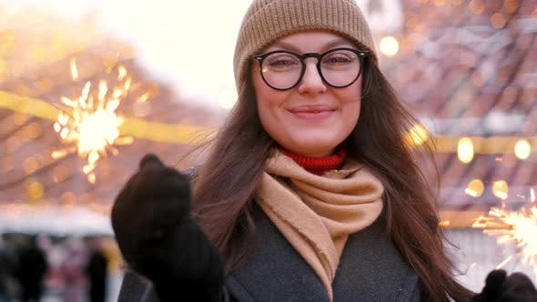 Thumbnail for Women with Sparklers in Their Hands That Bokeh Cities Centre Background