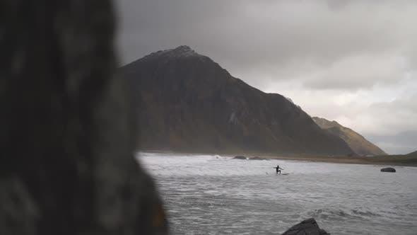 Surfer Surfing On Board In Rough Sea