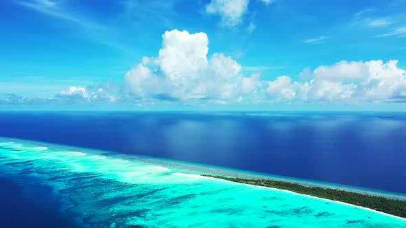 Thumbnail for Daytime fly over clean view of a sandy white paradise beach and aqua blue water background in high r