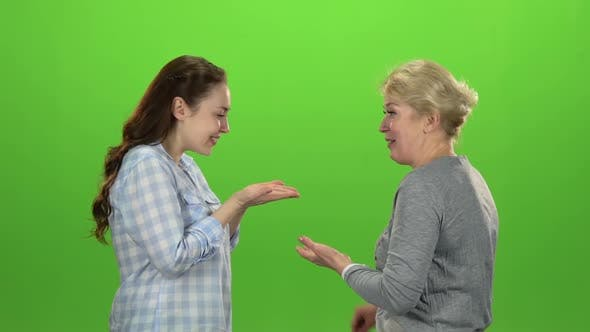 Thumbnail for Woman Gives the Keys To Her Daughter . Green Screen. Side View. Slow Motion