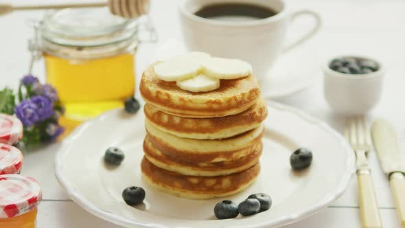 Pancakes with Slices of Banana and Berries