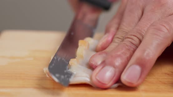 Cover Image for Cutting Fresh Geoduck on wooden board