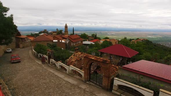 Thumbnail for Aerial view of old cobblestone street with beautiful houses in Sighnaghi town