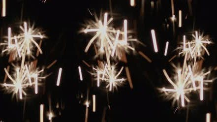 Thumbnail for Abstract sparklers burning in the black background. Holiday, celebration concept.