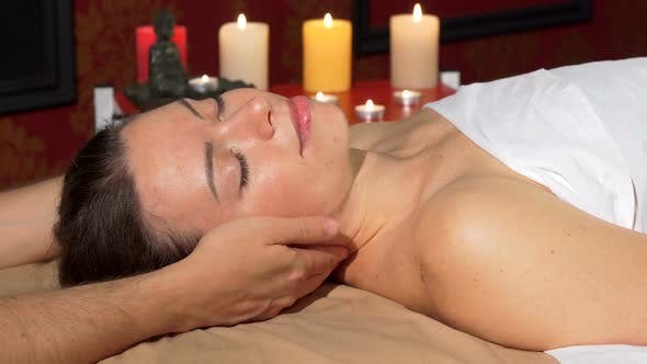 Cover Image for Happy Attractive Woman Smiling To the Camera After Relaxing Neck Massage