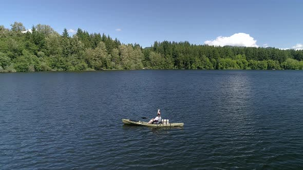 Thumbnail for Peaceful Aerial Of Man Casting Out Lake Fishing From Kayak