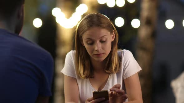 Thumbnail for Attractive Young Woman on a Date Using Mobile Phone and Does Not Pay Attention To the Boy.