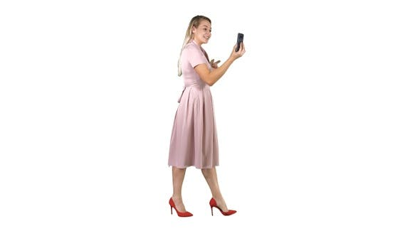 Thumbnail for Young woman in pink holding using smart phone recording
