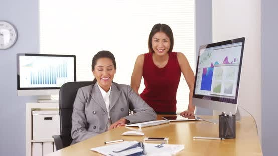 Thumbnail for Mixed race business executives smiling at camera