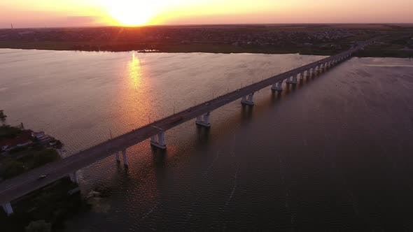Aerial Shot of a Straight Bridge Over the Dnipro at a Violet Sunset in Summer