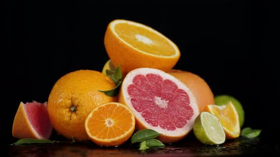 Juicy Pieces of Citrus Rotate Slowly.