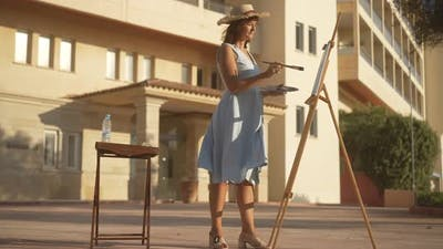 Wide Shot of Talented Confident Woman Painting in Sunlight Outdoors and Leaving