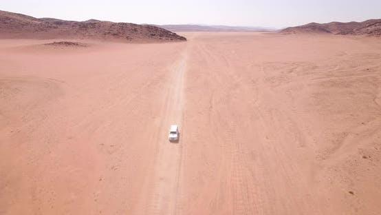 Vehicles Travel in Desert