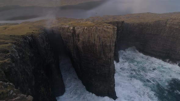 Thumbnail for Drone Footage of Waves Crashing into Shoreline Cliffs
