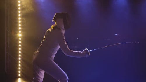 Two Female Athletes Practice Their Foil Skills at a Fencing Tournament