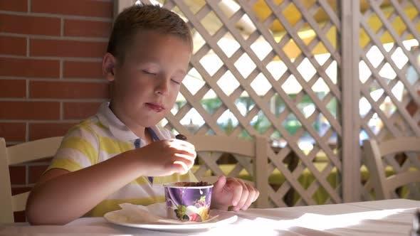 Thumbnail for Little Sweet Tooth Enjoying Ice Cream Dessert in Summer Cafe