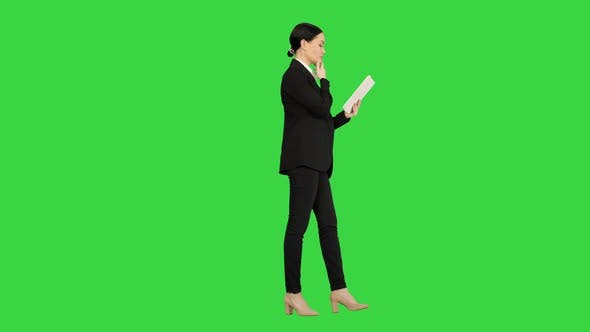 Thumbnail for Businesswoman Using a Tablet Pad While Walking on a Green Screen, Chroma Key.