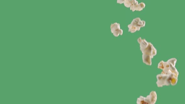 Popping Popcorn Flying and Falling Isolated on ChromaKey Background