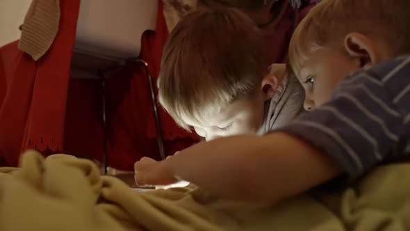 Cover Image for Little Brothers Playing on Digital Tablet