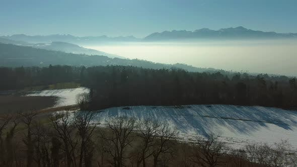 Thumbnail for Lake Geneva with Mist in Winter Morning. Swiss Alps, Switzerland. Aerial View
