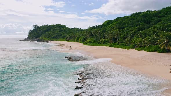Thumbnail for Seychelles. Aerial View of Ocean Waves Rolling To White Sand Tropical Deserted Beach