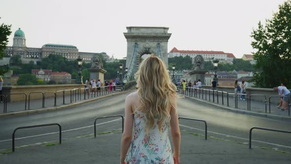 Thumbnail for Woman walking towards the Chain Bridge