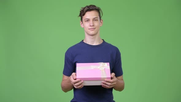 Thumbnail for Young Handsome Teenage Boy with Gift Box