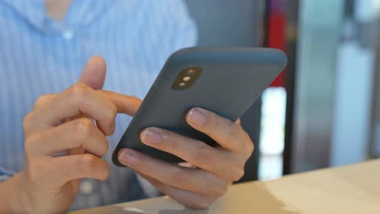 Cover Image for Woman use of mobile phone in restaurant