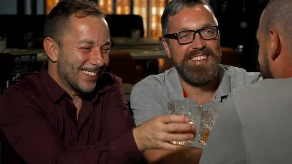 Thumbnail for Mature Happy Man Toasting with His Whiskey Glass Smiling To the Camera