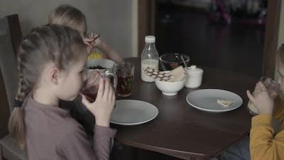 Children at Home at Breakfast