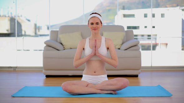 Thumbnail for Content Calm Woman Meditating In Her Living Room