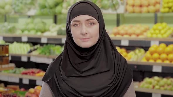 Thumbnail for Portrait of Young Muslim Woman Standing in Grocery and Looking at Camera. Beautiful Girl in Hijab