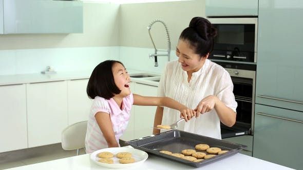 Thumbnail for Mother And Daughter Taking Cookies