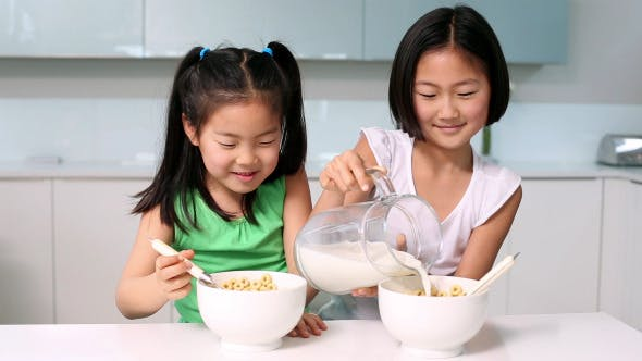 Thumbnail for Two Girls Eating Cereal