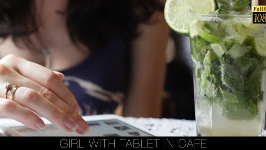 Cover Image for Girl With Tablet In Cafe 10