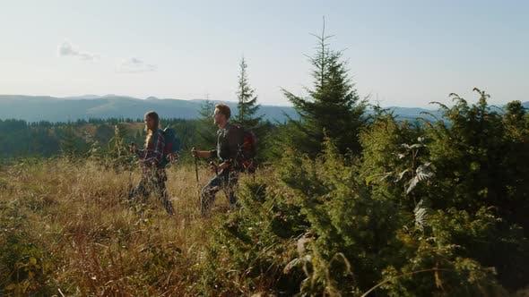 Couple Trekking in Mountains