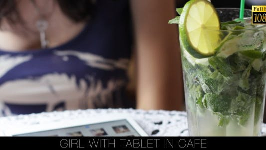 Cover Image for Girl With Tablet In Cafe 15