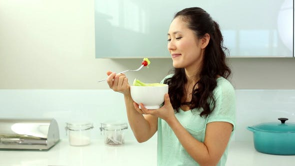 Thumbnail for Smiling Woman Eating Salad
