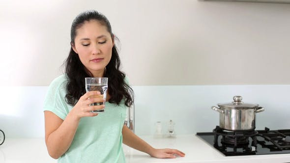 Thumbnail for Smiling Woman Drinking Glass Of Water